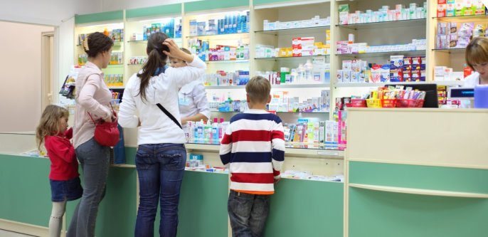 people buying a medicine in the pharmacy