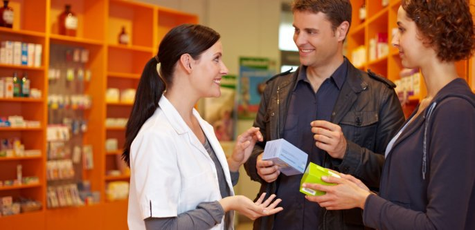 Pharmacist explaining the medicine to her customers