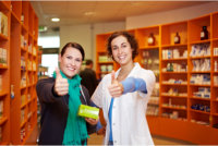 Pharmacist with her customer doing a thumbs up